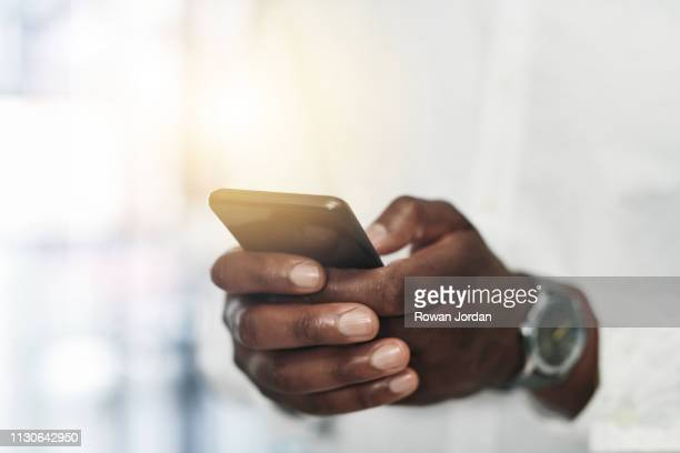 his cellphone helps him manage his busy work schedule - bring your own device stock pictures, royalty-free photos & images