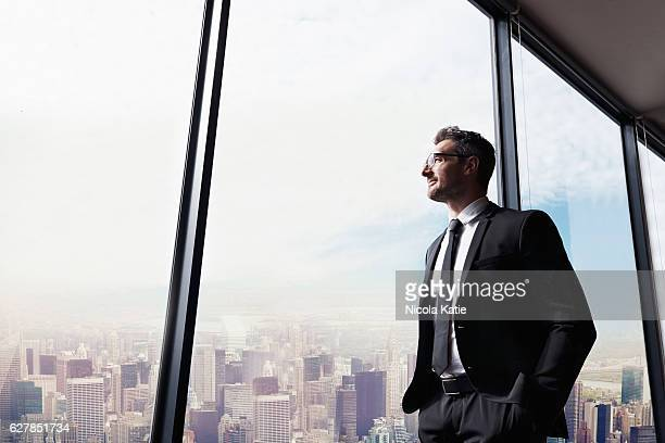his city, his business - looking through window stock pictures, royalty-free photos & images