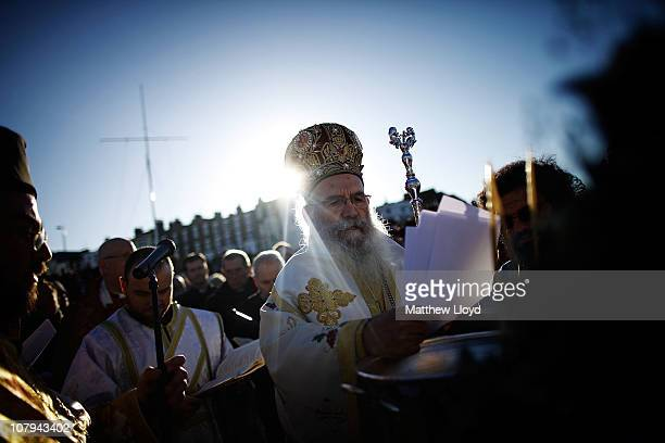 His Eminence Gregorios, Greek Orthodox Archbishop of Thyateira and Great Britain conducts a ceremony to bless the waters of the seaside town of...