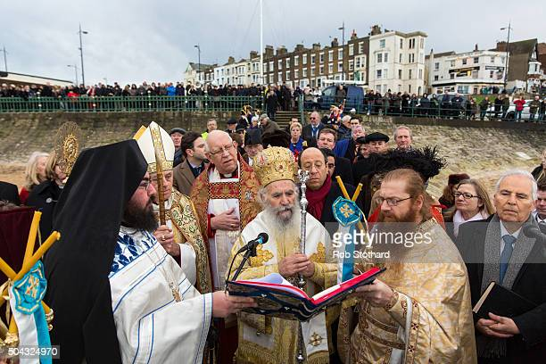 His Eminence Gregorios Greek Orthodox Archbishop of Thyateira and Great Britain offers a blessing at Margate beach for the Feast of the Epiphany on...