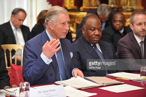 His Excellency Mr Ali Bongo President of Gabon listens as Prince Charles Prince of Wales talks during a meeting of international leaders to discuss...