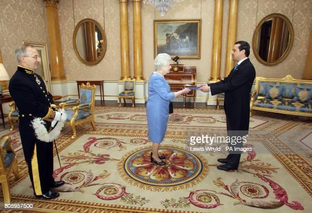 His Excellency the Ambassador Mr Werner Matias Romero of El Salvador presents his Credentials to Britain's Queen Elizabeth II at Buckingham Palace in...