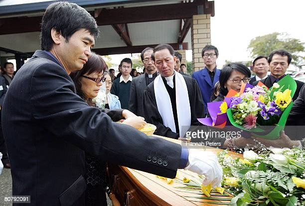 His father Wenjen Hsu and mother Hsiu Chuan Chen scatter petals on their son Tom Hsu's coffin after his funeral at Elim Christian College on April 21...