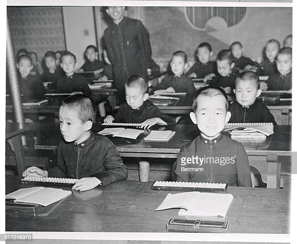 His Highness in School Nikko Japan His Highness Prince Masahito Yoshinomiya attired in the same uniform as the other students smiles over his books...