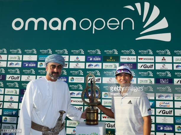 His Highness Sayyid Taimur bin Assad al Said presents Kurt Kitayama of USA with the winners trophy after winning the Oman Golf Classic at Al Mouj...