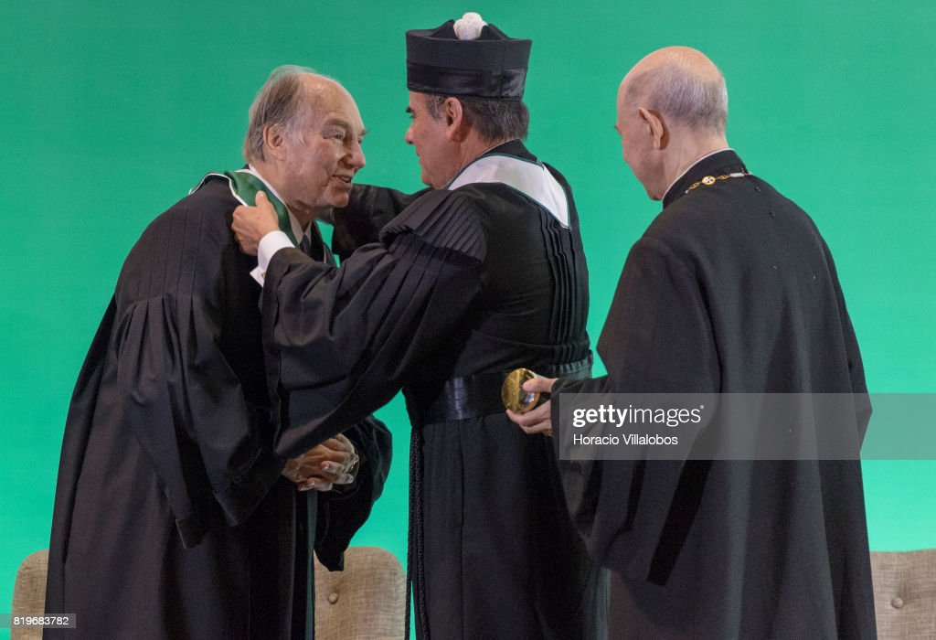His Highness Shah Karim al-Hussaini, Prince Aga Khan, receives medal and diploma from Antonio Manuel Bensabat Rendas, Rector of NOVA University of Lisbon, during the ceremony in which Prince Aga Khan was awarded with the Honoris Causa Doctorate on July 20, 2017 in Lisbon, Portugal. Prince Shah Karim Al Hussaini, Aga Khan IV, is the 49thÊImamÊofÊNizari Ismailism. He has held this position since 11 July 1957, when he succeeded his grandfather,ÊSir Sultan Muhammad Shah Aga Khan III. It is believed that the Aga Khan is a direct lineal descendant of the Islamic prophetÊMuhammad. The Aga Khan as one of the world's ten richest royals. He is the founder and chairman of theÊAga Khan Development Network, one of the largest private development networks in the world. The organization works toward improvement of the environment, health, education, architecture, culture,Êmicrofinance, rural development, disaster reduction, the promotion of private-sector enterprise and the revitalization of historic cities.