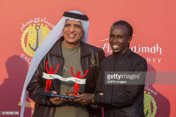 His Highness Sheikh Saud Bin Saqr Al Qasimi hands over the winner's trophy to Fancy Chemutai from Kenya who won the woman's RAK Half Marathon in a...