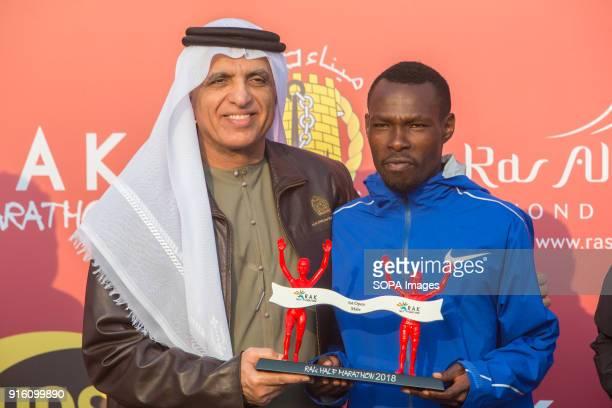 His Highness Sheikh Saud Bin Saqr Al Qasimi hands over the winner's trophy to Bedan Karoki from Kenya who won the Men's RAK Half Marathon in a time...