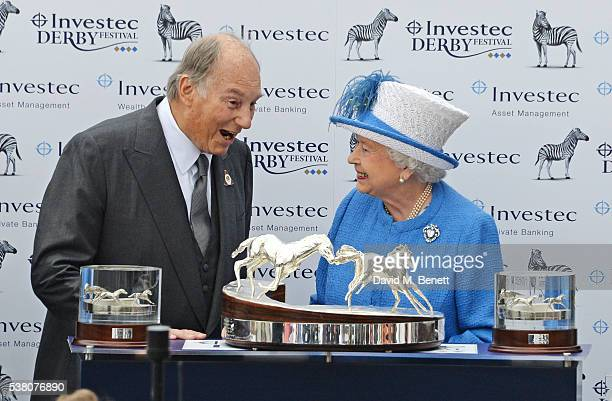 His Highness The Aga Khan receives the Investec Derby trophy for his winning horse Harzand from HRH Queen Elizbaeth II during Derby Day at the...