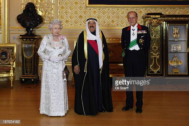 His Highness the Amir Sheikh Sabah AlAhmad AlJaber AlSabah of Kuwait poses with Queen Elizabeth II and Prince Philip the Duke of Edinburgh in Windsor...