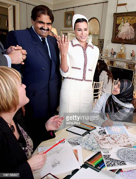 His Highness the Emir of the State of Qatar Sheikh Hamad bin Khalifa Al Thani and his wife Sheikha Mozah bint Nasser AlMissned share a smile with...