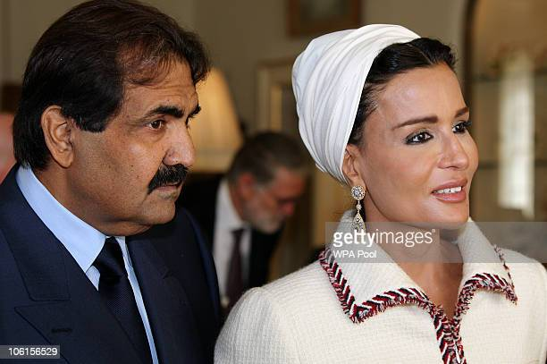 His Highness the Emir of the State of Qatar Sheikh Hamad bin Khalifa Al Thani and his wife Sheikha Mozah bint Nasser AlMissned walk together after...