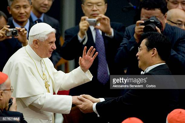His holiness Pope Benedict XVI greets chinese Doublebass player Dongjian Gong at the end of a special concert performed by the China Philharmonic...