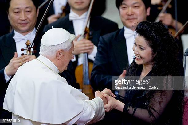 His holiness Pope Benedict XVI greets chinese soprano Lan Rao at the end of a special concert performed by the China Philharmonic Orchestra and...