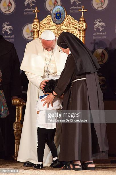 CONTENT] His Holiness Pope Francis blessing a child in the newly built catholic church on the banks of the River Jordan His visit to Jordan was part...