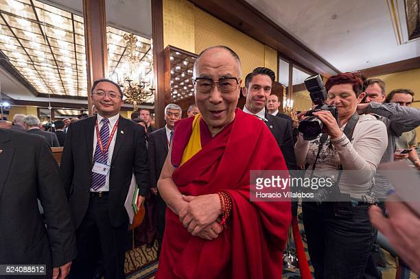 His Holiness the 14th Dalai Lama Tenzin Gyatso arrives to meet with journalists at a press conference in Frankfurt Germany 14 may 2014 during the...