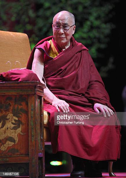 His Holiness the Dalai Lama addresses an audience at the Manchester Arena on June 17 2012 in Manchester England The exiled Buddhist Tibetan leader is...