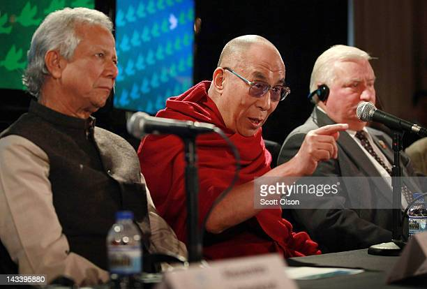 His Holiness the Dalai Lama answers questions during a press conference flanked by Professor Muhammed Yunus and former Polish President Lech Walesa...