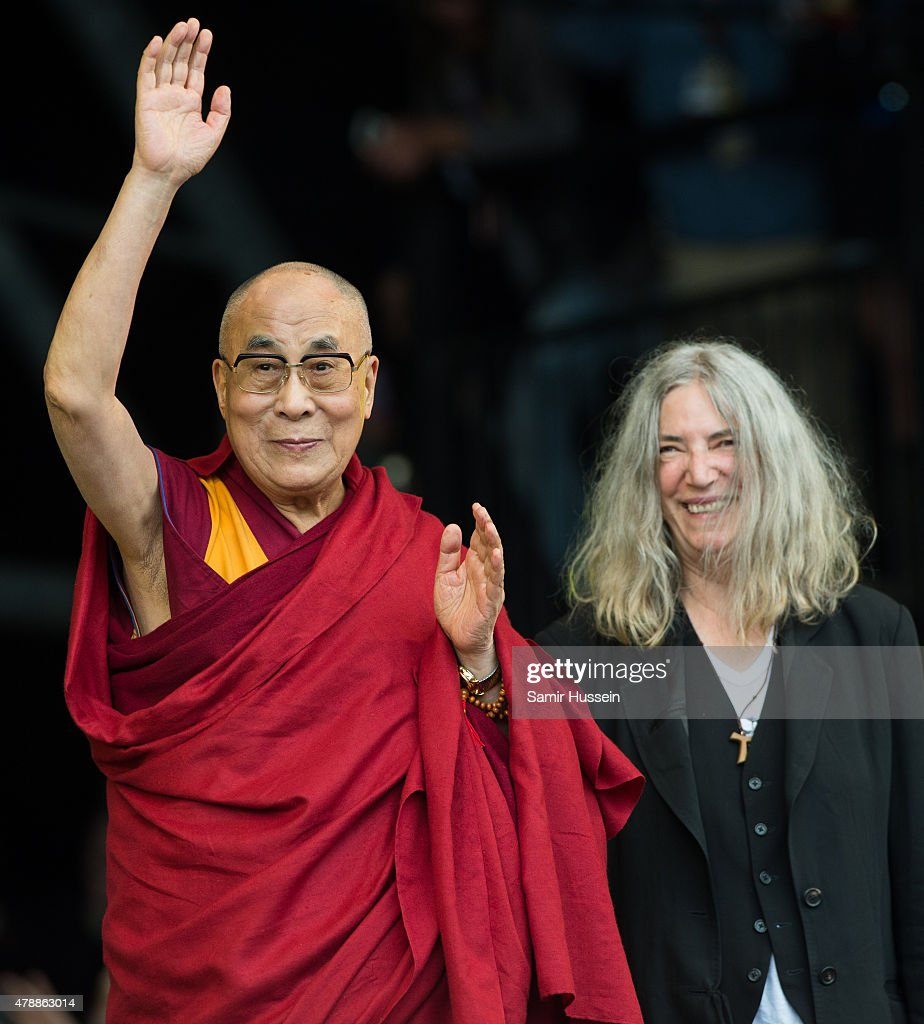 His Holiness The Dalai Lama appears on stage with Patti Smith as she performs at the Glastonbury Festival at Worthy Farm, Pilton on June 28, 2015 in Glastonbury, England.