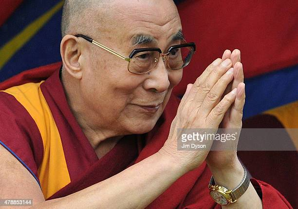 His holiness the Dalai Lama arrives to give a talk during the third day of Glastonbury Festival at Worthy Farm Pilton on June 28 2015 in Glastonbury...