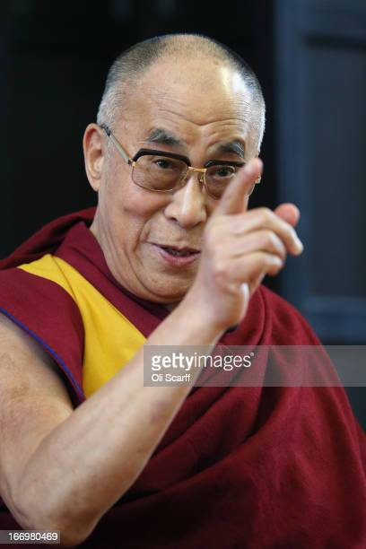 His Holiness the Dalai Lama attends a press conference in the Divinity School of St John's College part of the University of Cambridge on April 19...