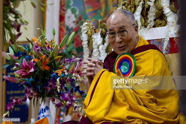 His Holiness the Dalai Lama gesture during the long life prayer at Tsugla Khang Temple Mcleodganj Dharamshala Hundred of Tibetan in exile and Tibetan...
