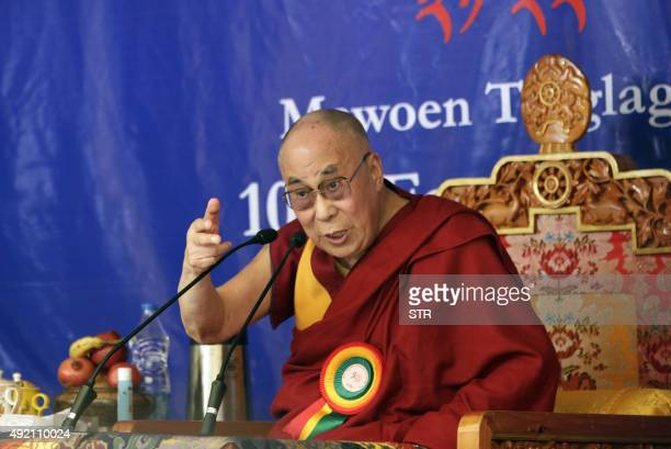 His Holiness the Dalai Lama gestures at a function in Dharamsala on October 10 2015 The Dalai Lama said he was in 'excellent' health earlier in...