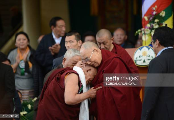 His Holiness the Dalai Lama greets his former physician Dr Yeshi Dhonden during the Centenary celebration of the MenTseeKhang in McLeod Ganj on March...