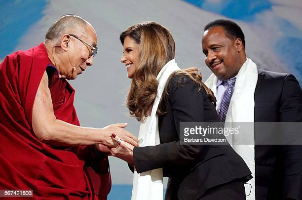 LOSANGELES CA 022514 His Holiness the Dalai Lama greets Maria Shriver and Mayor of Inglewood James T Butts before his speech at the Forum in...