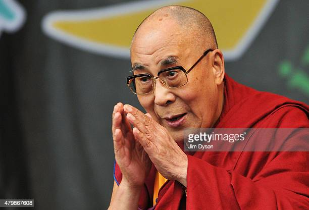His holiness the Dalai Lama joins Patti Smith on the Pyramid stage during the third day of the Glastonbury Festival at Worthy Farm Pilton on June 28...