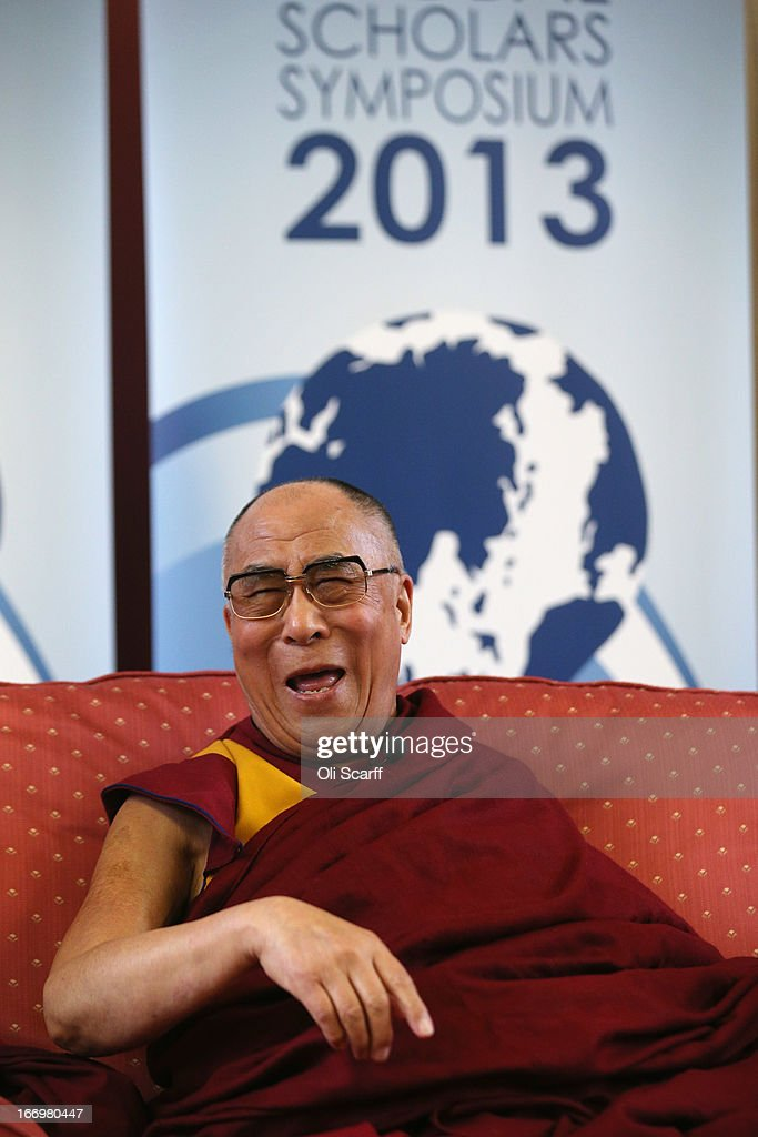 His Holiness the Dalai Lama laughs during a press conference in the Divinity School of St. John's College, part of the University of Cambridge, on April 19, 2013 in Cambridge, England. The Dalai Lama was invited to address an audience in St. John's College by the Global Scholars Symposium during his 5-day visit to the UK. The exiled 77-year-old Buddhist Tibetan leader spoke on themes of non-violence, compassion, dialogue and universal responsibility.