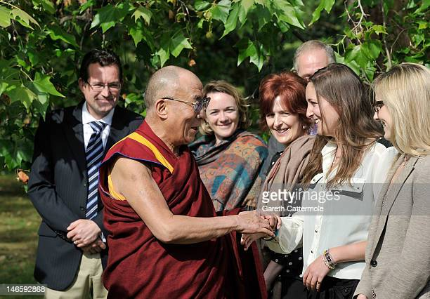 His Holiness the Dalai Lama meets staff members as he is recieved by Prince Charles Prince of Wales and Camilla Duchess of Cornwall at Clarence House...