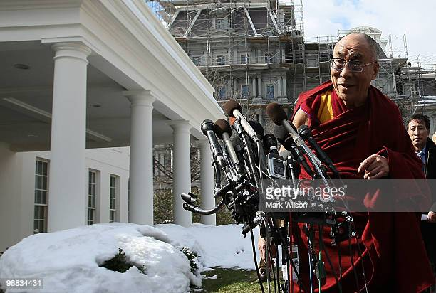 His Holiness The Dalai Lama walks up to the microphones to speak at the White House on February 18 2010 in Washington DC The Dalai Lama spoke to...
