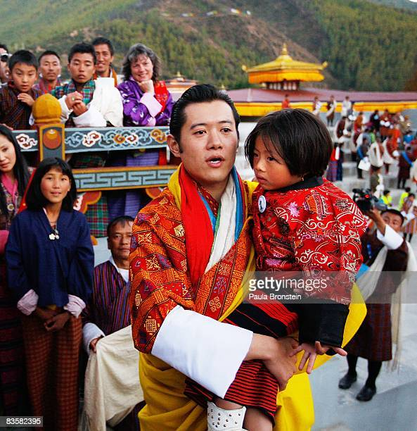 His Majesty Jigme Khesar Namgyel Wangchuck carries a child as he greets his people at the ceremonial grounds of The Tendrey Thang on November 6 2008...