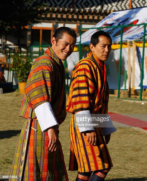 His Majesty Jigme Khesar Namgyel Wangchuck walks along side his father former King Jigme Singye Wangchuck as they leave during a coronation...