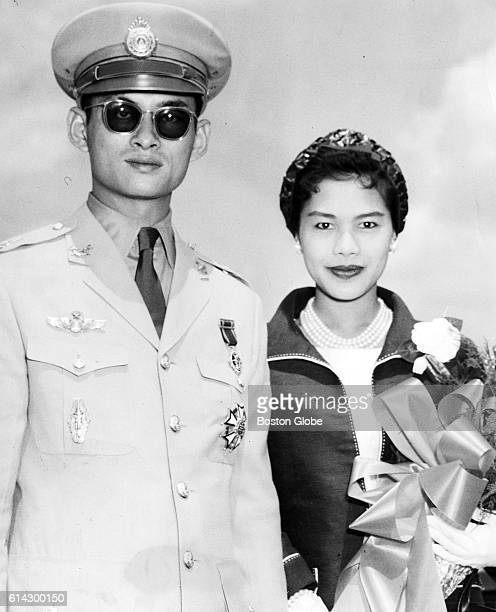 His Majesty King Bhumibol Adulyadej of Thailand and his wife Queen Sirikit at Logan International Airport in Boston when the monarch arrived in his...