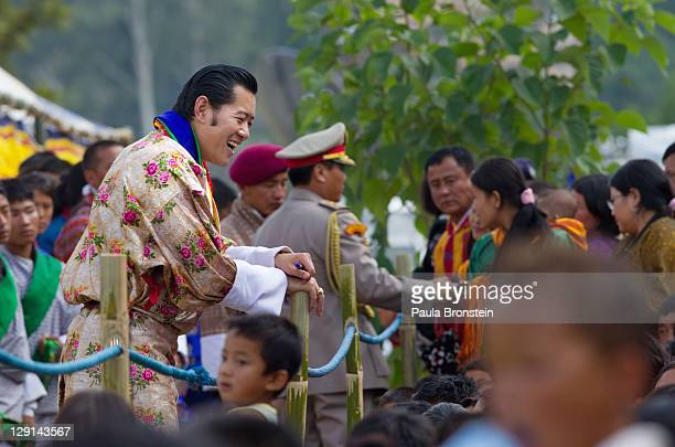 His majesty King Jigme Khesar Namgyel Wangchuck, 31 and Queen Jetsun Pema greet well wishers as they walk out after their marriage ceremony is...