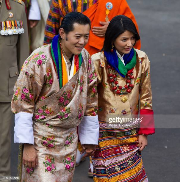 His majesty King Jigme Khesar Namgyel Wangchuck 31 and Queen Jetsun Pema greet well wishers as they walk out after their marriage ceremony is...