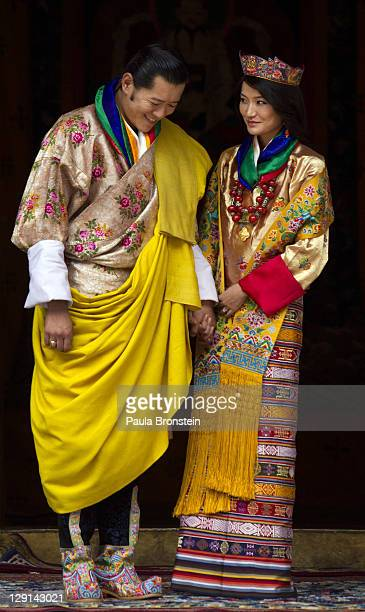 His majesty King Jigme Khesar Namgyel Wangchuck, 31 and the Queen Jetsun Pema walk out after their marriage ceremony is completed on October 13, 2011...