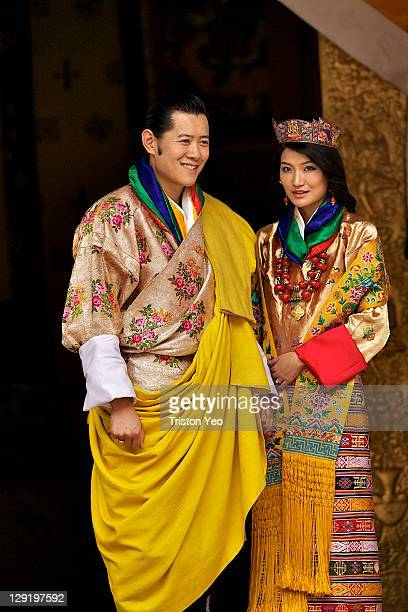 His majesty King Jigme Khesar Namgyel Wangchuck and Queen Jetsun Pema walk out after their marriage ceremony is completed on October 13 2011 in...