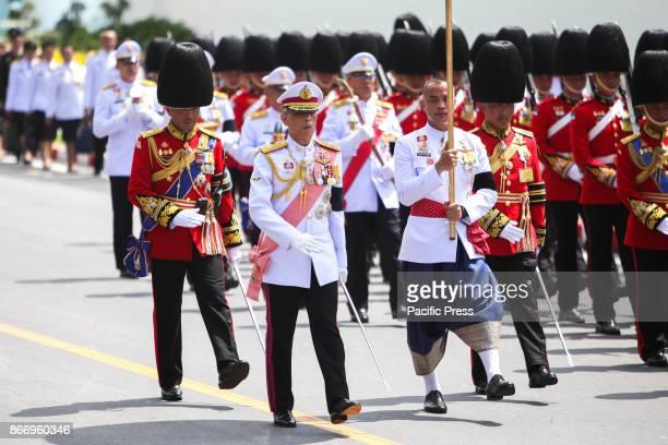 His Majesty King Maha Vajiralongkorn Bodindradebayavarangkun joins a procession to transfer His Majesty the late King Bhumibol Adulyadejs royal...