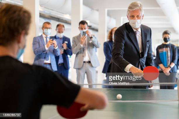 His Majesty King Philippe of Belgium practises his table tennis skills with a paralysed patient during his visit to the REVAlution, the To Walk Again...