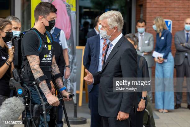 His Majesty King Philippe of Belgium talks to a paralysed Kosovo war veteran wearing a full body harness after his visit to the REVAlution, the To...