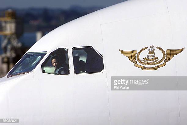 His Majesty Sultan Haji Hassanal Bolkiah of Brunei arrives in Auckland for the APEC conference in the cockpit of his planeThe Sultan holds a full...