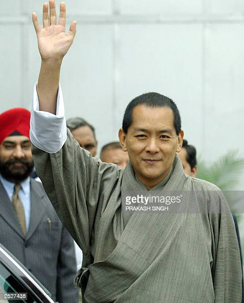His Majesty the King of Bhutan Jigme Singye Wangchuck waves as he arrives at Indira Gandhi International Airport in New Delhi 14 September 2003...