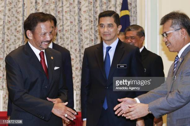His Majesty the Sultan and Yang DiPertuan of Brunei Darussalam Sultan Hassanal Bolkiah and Malaysian Prime Minister Mahathir Mohamad attend to...