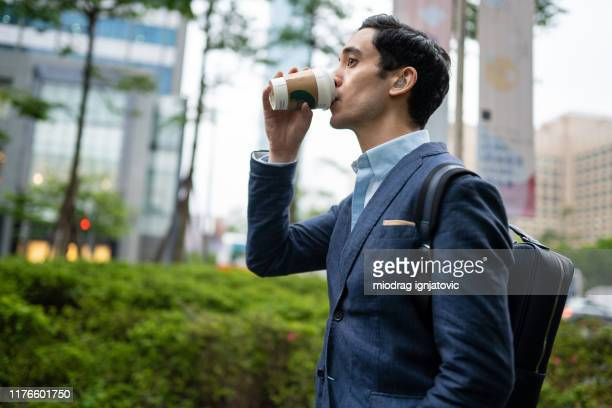 his morning routine on his way to work - hearing aid stock pictures, royalty-free photos & images