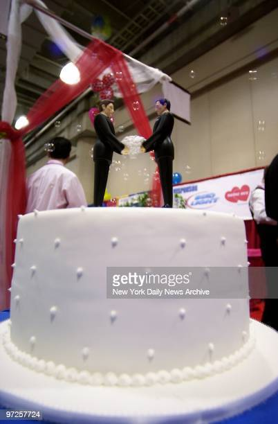 His 'n' his wedding cake toppers from The Knot are on display during the Same Sex Wedding Expo at the Javits Convention Center Offering everything...