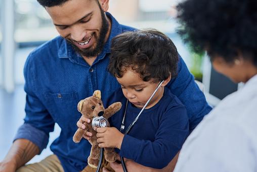 His pediatrician makes each visit as fun as possible 1049284376