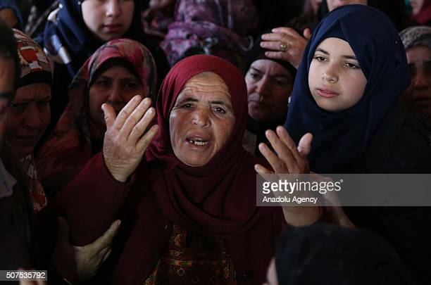 His relatives mourn during the funeral ceremony of 22yearold Palestinian Ibrahim Allan who was killed in alleged knife attack by Israeli soldiers...